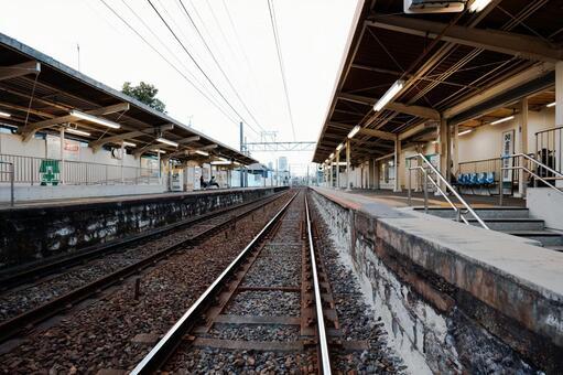 Station platform and railroad tracks