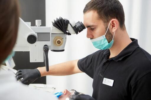 Male dentist with microscope treatment 9