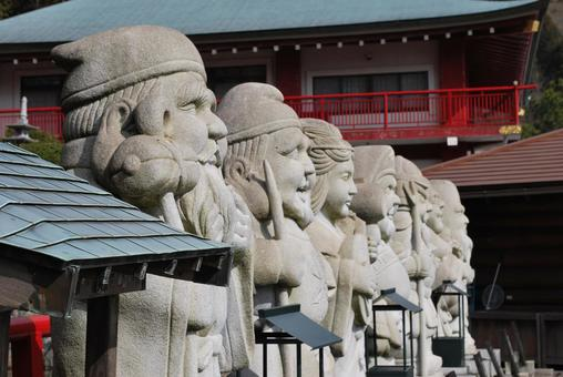 Stone statue of the Seven Lucky Gods