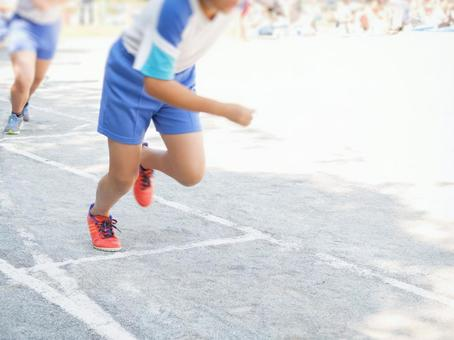 Elementary school students making a start dash at an athletic meet