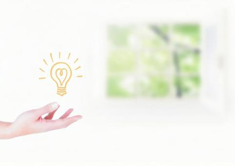 Hands floating light bulbs White interior