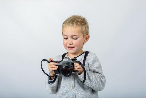 Boy with camera 13