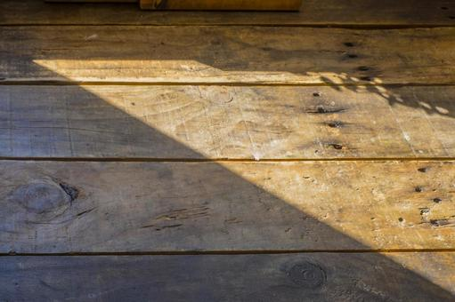 Wooden dining table in the light