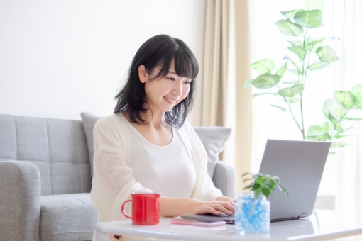 Image of a young woman operating a personal computer