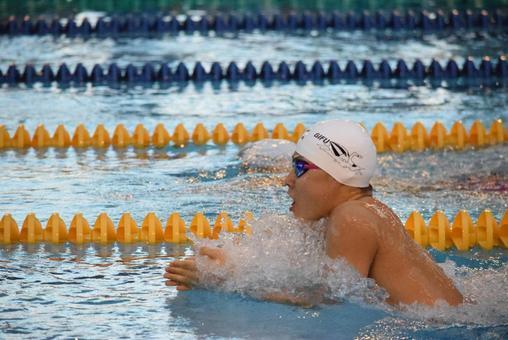 Athlete swimming in breaststroke