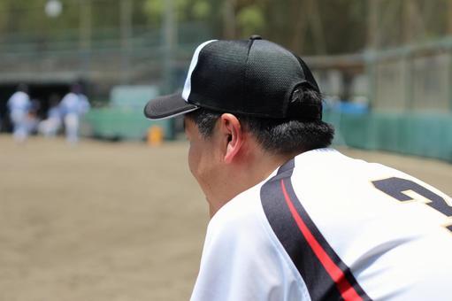 Male baseball person back