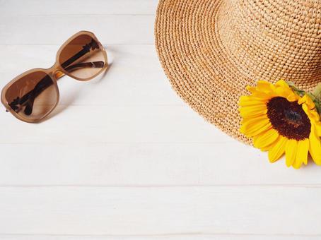 Image of summer Sunflower and sunglasses (round straw hat)