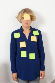 Working mother whose upper body is full of sticky notes 8