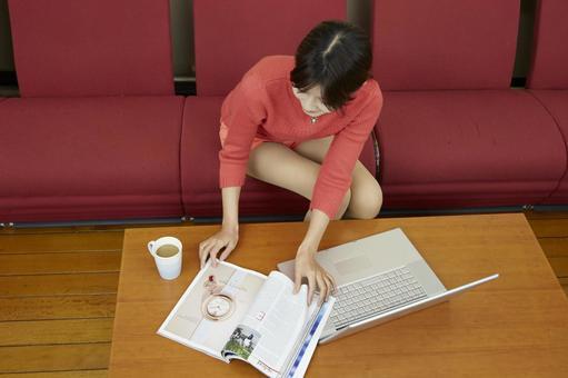 A woman watching a magazine 13