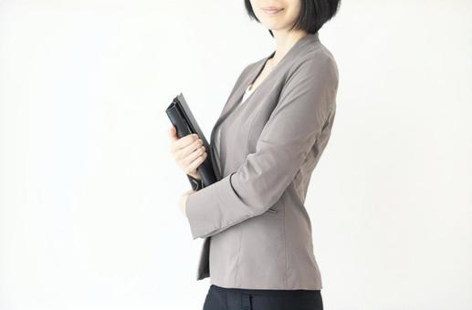 Image of a woman with a business file