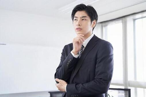 Japanese male businessman thinking in the conference room