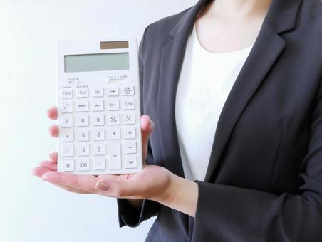 Woman in suit with calculator