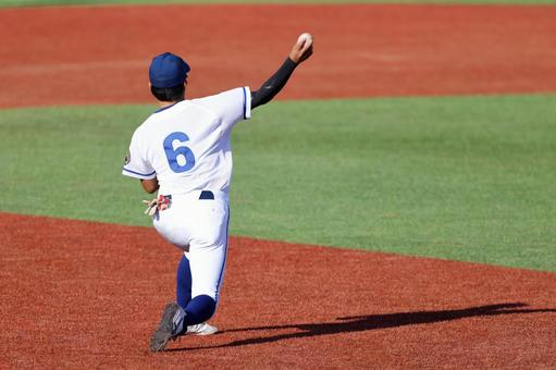 Infielder throwing to 1st base