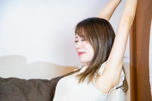 A woman stretching on the sofa