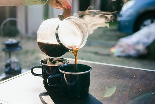 Coffee pouring in camp