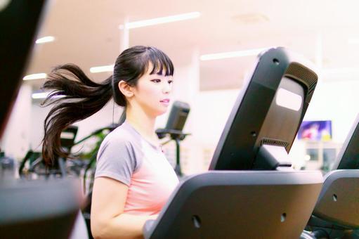 Woman running on running machine 2