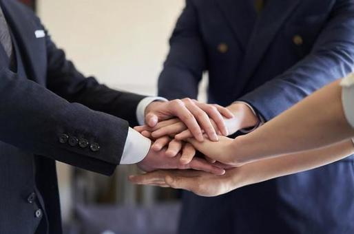 Asian business person holding hands