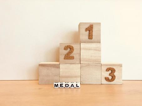 Gold, silver and bronze medals, podium