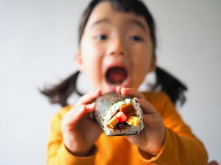 Girl eating ehomaki