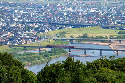 Trains and streets crossing the Hii River in Izumo City