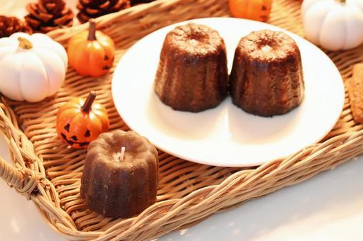 Candy canelé and candle canelé