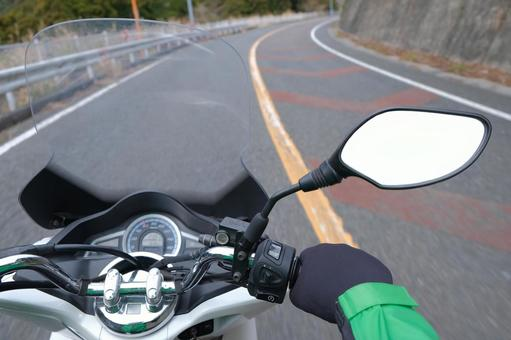 Driving on a motorcycle Biker's eyes Touring image material