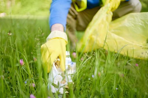 Volunteer hand picking garbage