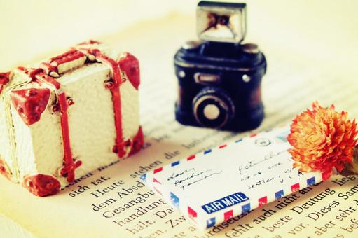 Miniature camera and trunk and letter