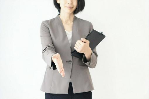 Image of a woman seeking a business handshake