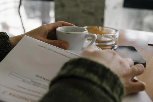 Hand with coffee at a coffee shop 1