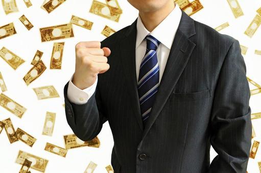 Businessman holding a fist 3 money