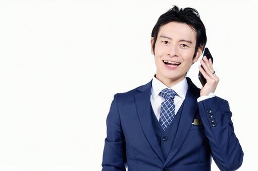 Hotel man using a smartphone 1