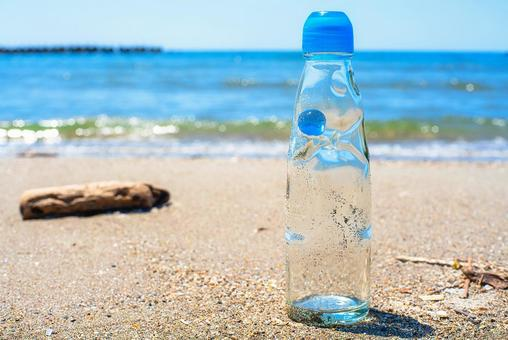 Sea, sandy beach and ramune bottle