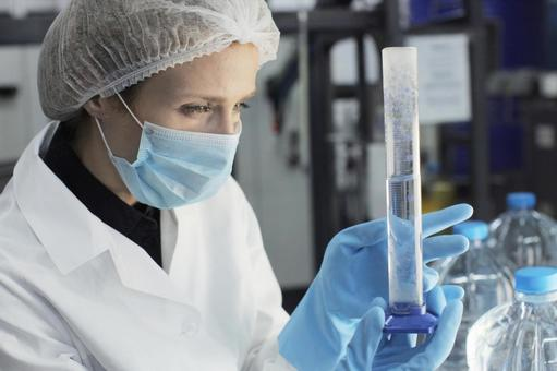 Female researcher with measuring cylinder 15
