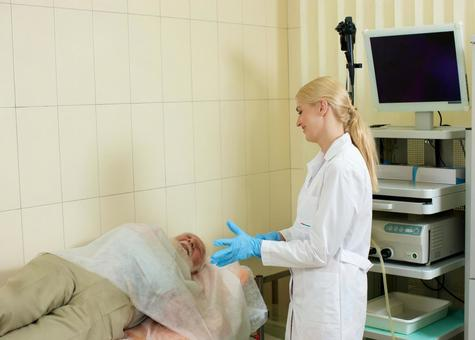 Foreign nurse female doctor examining with foreign nursing male receiving gastroscope camera examinations 8