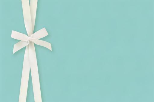 White ribbon frame on mint blue background 4