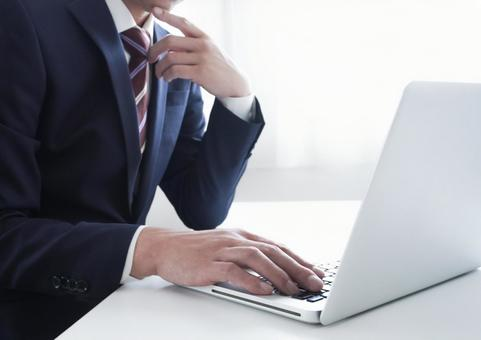 Laptop and male businessman