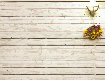 Wooden board wall decorated with pansies