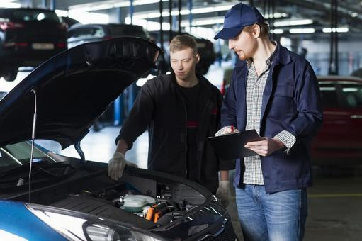 Automobile mechanic checking bonnet 13