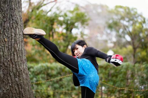 Woman training a kick