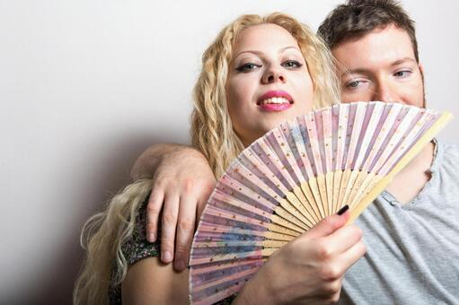 Women with folding fans and foreign men