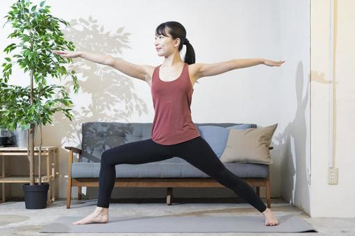 A woman doing yoga in the living space