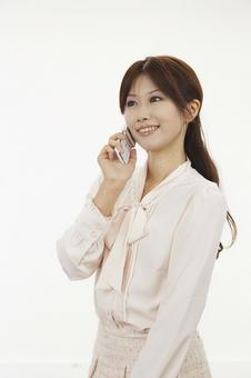 A woman holding a mobile phone 9