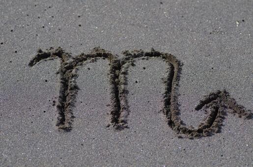 Scorpio mark (spiritual) written on the sandy beach