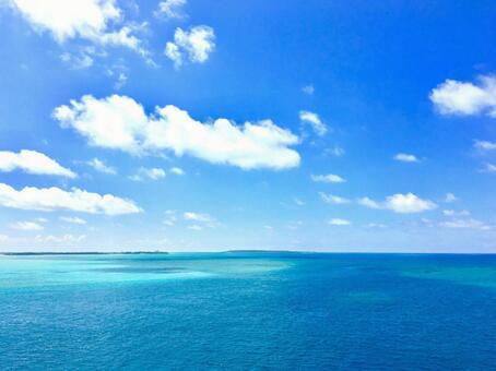 A beautiful blue sky and a sky blue sea