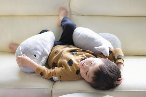 A 3-year-old child chilling on the sofa