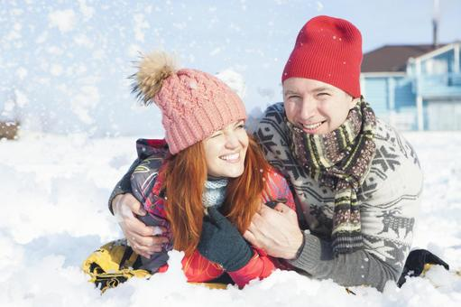 Couple lying on the snow 3