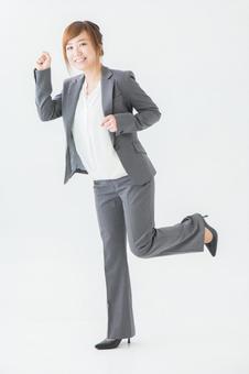 Running business woman