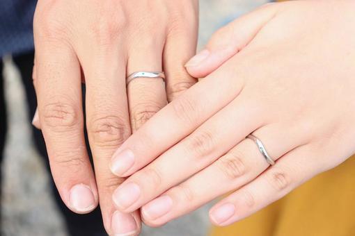 Newlyweds wearing wedding rings