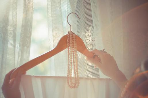 Necklace and cloth hung on hanger
